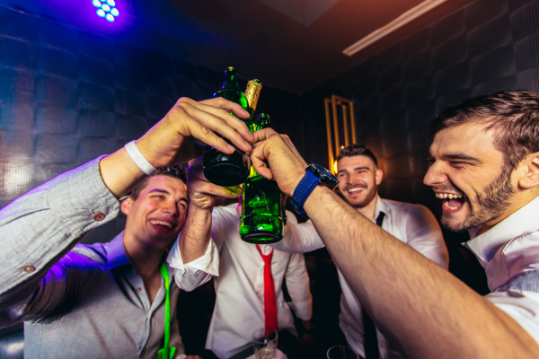 toasting beers at a bachelor party